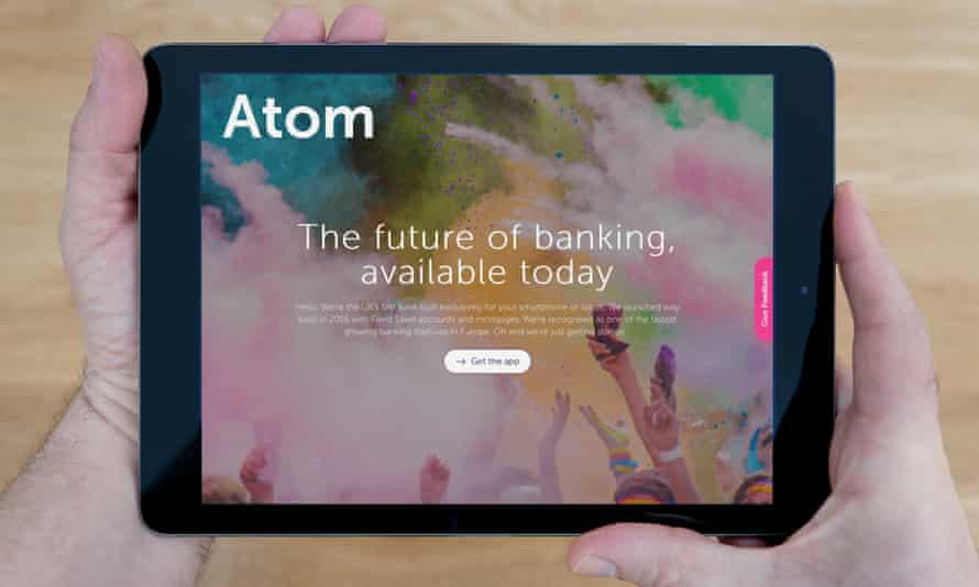 A man looks at the Atom Bank website on his iPad tablet