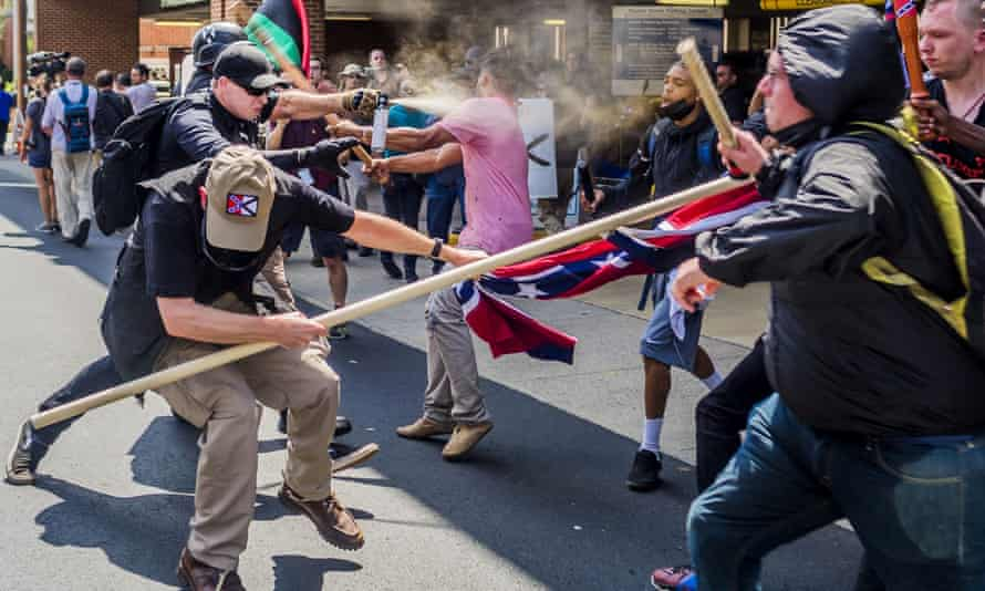 Far-right rally members clash with counter-protesters at the 'Unite the Right' rally in Charlottesville, Virginia, on 12 August 2017.