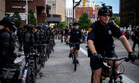 Police use bicycles to create cordons around protesters ahead of Republican National Convention in Cleveland