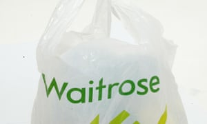 A Waitrose carrier bag. CEO Mark Price said the scheme 'could be very, very expensive for us but we think giving power to the customer on 1,000 lines to start with is the right thing to do'.
