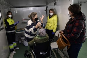 Residents applaud after being vaccinated with the Pfizer vaccine against coronavirus inside a mobile health unit in the small Pyrenees village of Oronoz-Mugaire, around 45 km (27 miles) from Pamplona, on 19 January, 2021.