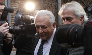 Dominique Strauss-Kahn leaves his hotel for a court in Lille.