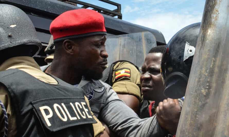 Robert Kyagulanyi, commonly known as Bobi Wine, being arrested by police