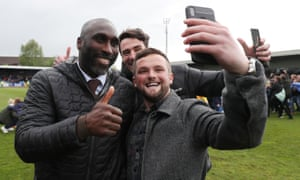 Sol Campbell celebrates with supporters after Macclesfield's survival was sealed.