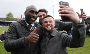 Sol Campbell poses for a selfie with a Macclesfield fan after they stayed up