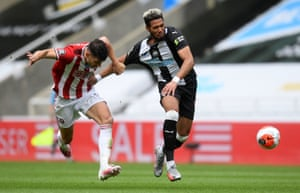 John Egan challenges Newcastle United's Joelinton leading to a second yellow card.