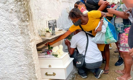 The girls are buried at the Nossa Senhora das Gracas cemetery in Duque de Caxias, Rio de Janeiro state, at the weekend.