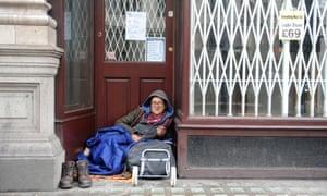 Homeless person in shop doorway