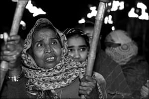 Resham Bai, from the J.P. Nagar neighbourhood of Bhopal near the site of the abandoned Union Carbide chemical plant, participates in a torchlight parade through the streets of the city to mark the 34th anniversary of the explosion.