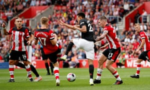 Southampton's Stuart Armstrong and Pierre-Emile Hojbjerg tussle with Manchester United's Mason Greenwood.