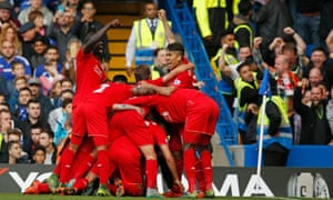 Liverpool mob Philippe Coutinho after his second goal against Chelsea.