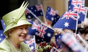 Queen Elizabeth II receives flowers from schoolchildren after the Commonwealth Day Service in Sydney, Australia, 13 March 2006