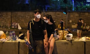 Demonstrators in Hong Kong take a rest after Wednesday's dramatic clashes with police