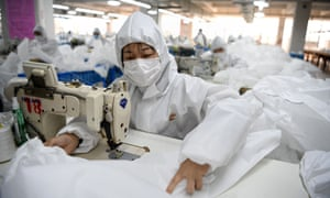 Workers in Wenshou sew hazardous material suits to be used in the Covid-19 coronavirus outbreak.