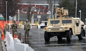 Members of the Maryland national guard control entry to a section of parking lot on the south side of FedEx Field on Monday that officials said will become a clinic for coronavirus health screenings.