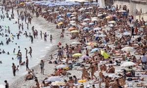 A beach full of sunbathers