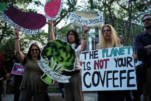 Angry environmental activists in New York display slogans of dismay against Trump's rejection of the global climate pact