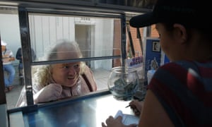 Jonathan Gold orders food from a taco truck.