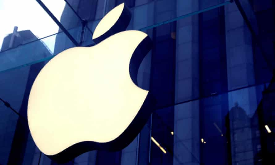 The Apple Inc logo is seen hanging at the entrance of a building