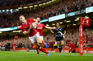 Wales' George North goes over.