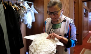 Justice Ruth Bader Ginsburg showing one of the many different collars (jabots) she wears with her robes in 2016.