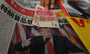 A news stand in Beijing: US president-elect Donald Trump has accused China of currency manipulation.