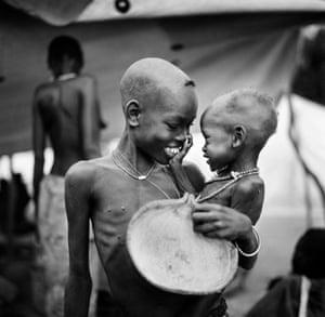 A moment of joy between siblings at Ajiep, in Bahr el Ghazal province, in what is now South Sudan, during the devastating famine of 1998
