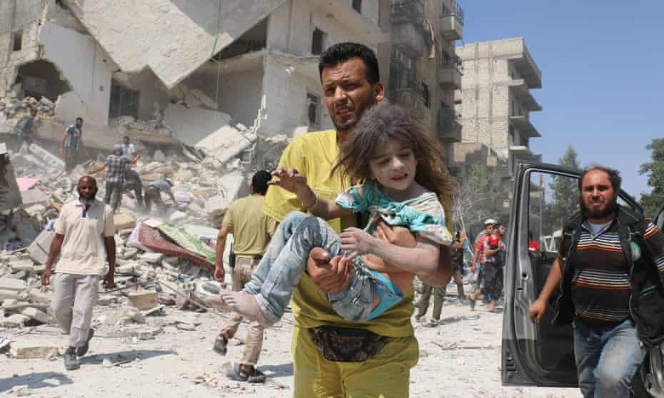 Rescue workers in Aleppo after a reported barrel bomb attack by regime aircraft