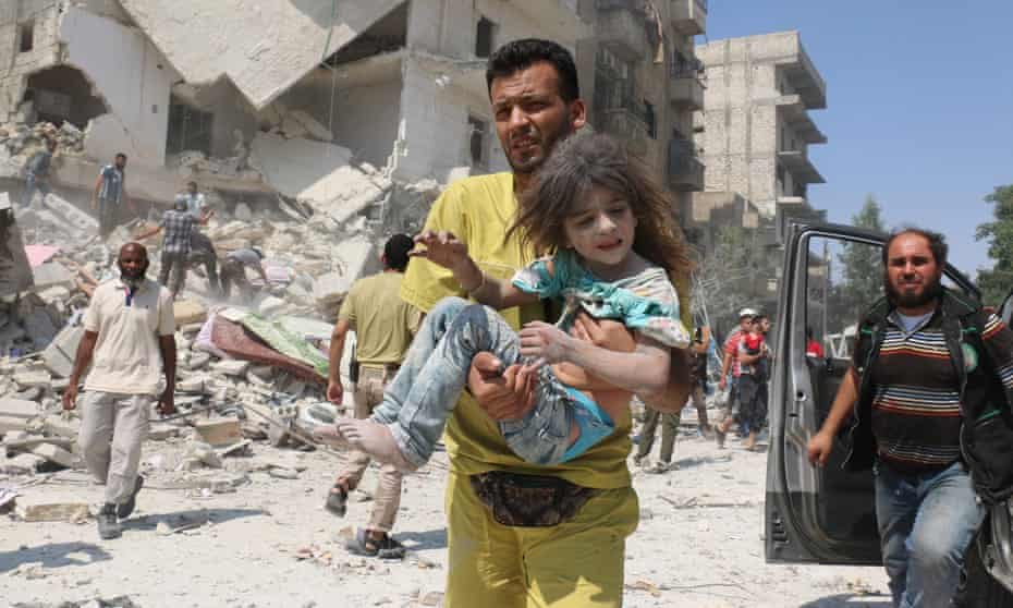 A man carries a wounded child in the Maadi district of eastern Aleppo after regime aircraft reportedly dropped explosive-packed barrel bombs on 27 August 2016.