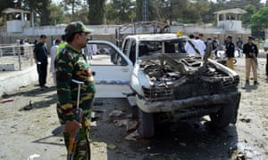 Security personnel at the site of the suicide car bomb attack in Quetta.