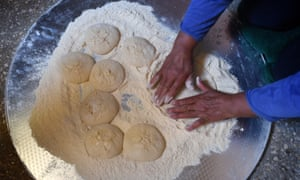 Taken  from above, a shot of a person traditional bread-making in Jordan.