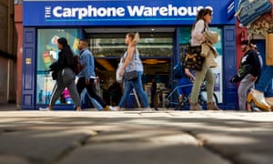 People walking past Carphone Warehouse store in Manchester