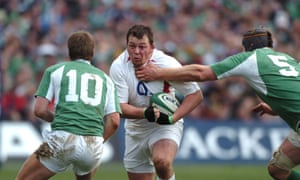 Ireland v England. Steve Thompson (England) is collared by Paul O'Connell (5) as he runs at Ireland's Ronan O'Gara (10). Photo by Matt Impey/Rex/Shutterstock