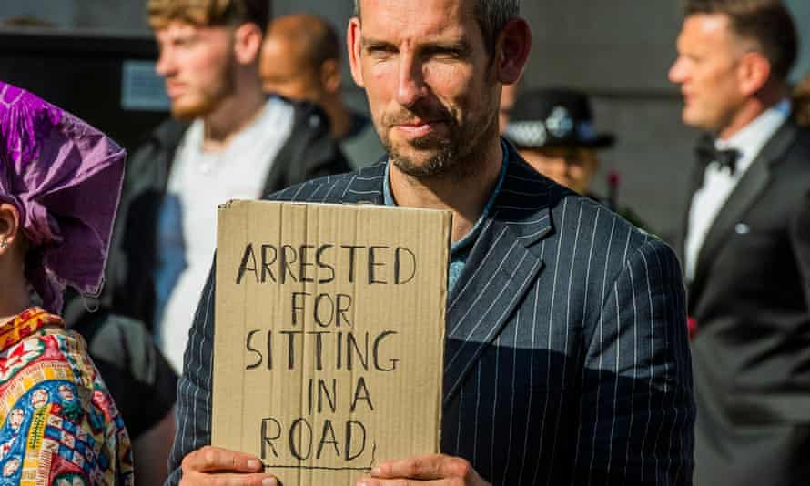 Etienne Stott gave a speech saying he was breaking the law by violating the conditions of his bail.
