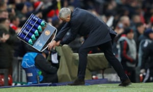José Mourinho reacts to Fellaini's late winner by throwing a crate of bottles to the ground.
