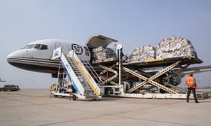 Medical materials are unloaded from a plane at Wuhan airport
