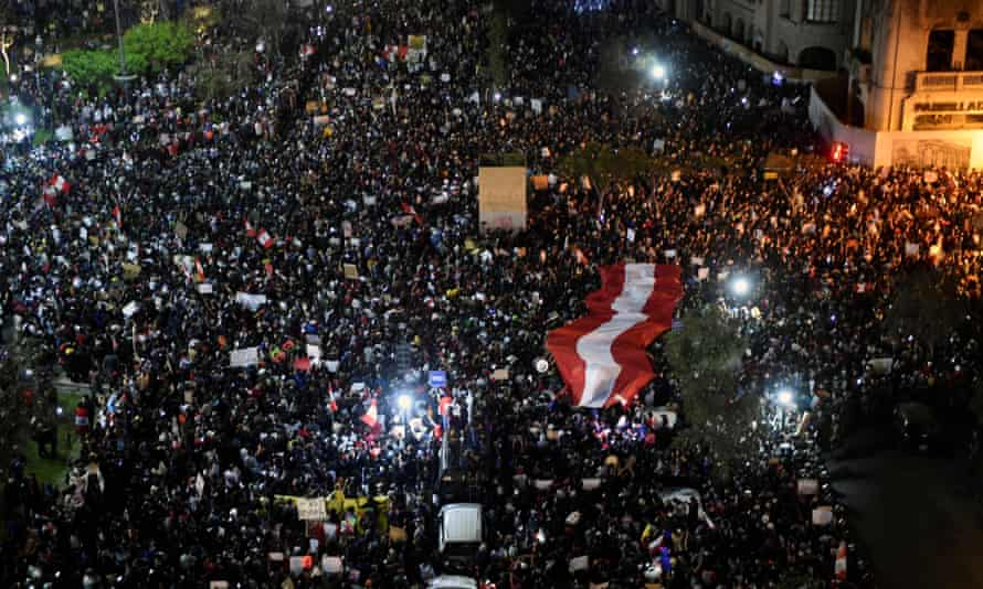 Demonstrators hold a protest against the new government of the interim president, Manuel Merino, at the San Martin square in Lima on Thursday, following the removal of former president Martín Vizcarra.