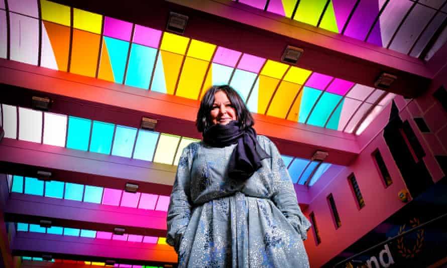 Chenine Bhathena under colourful ceiling