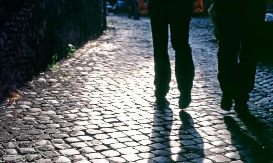 People walking along a cobbled street