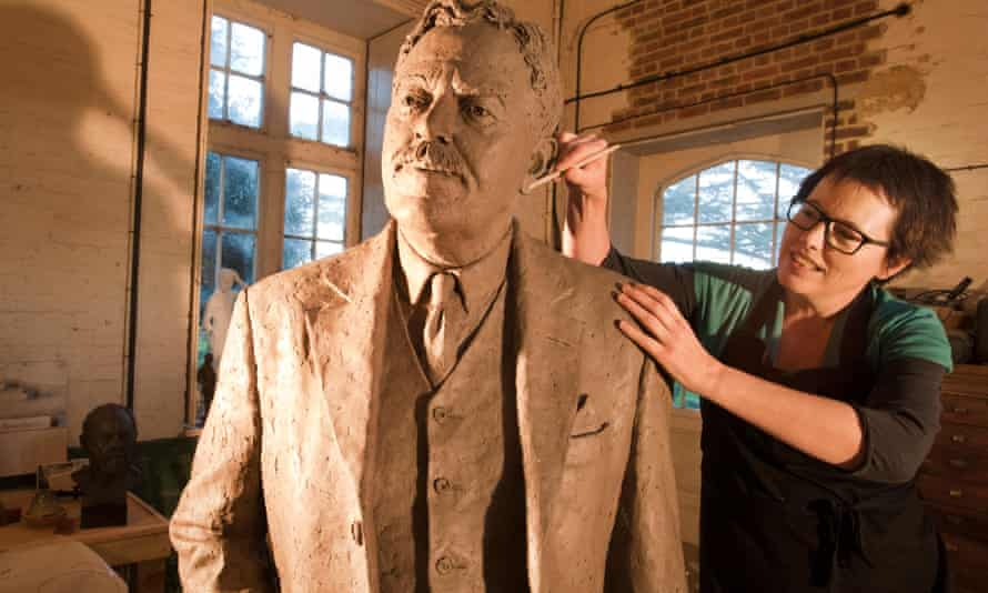Sculptor Hazel Reeves works on the statue of Sir Nigel Gresley which will stand in London's Kings Cross station..