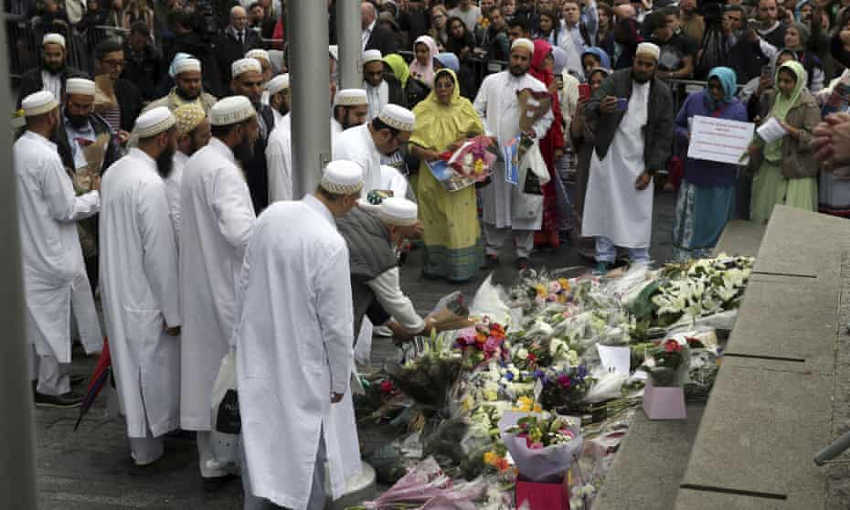 People lay flowers after a vigil for victims of Saturday's attack in London Bridge, at Potter's Field Park in London,