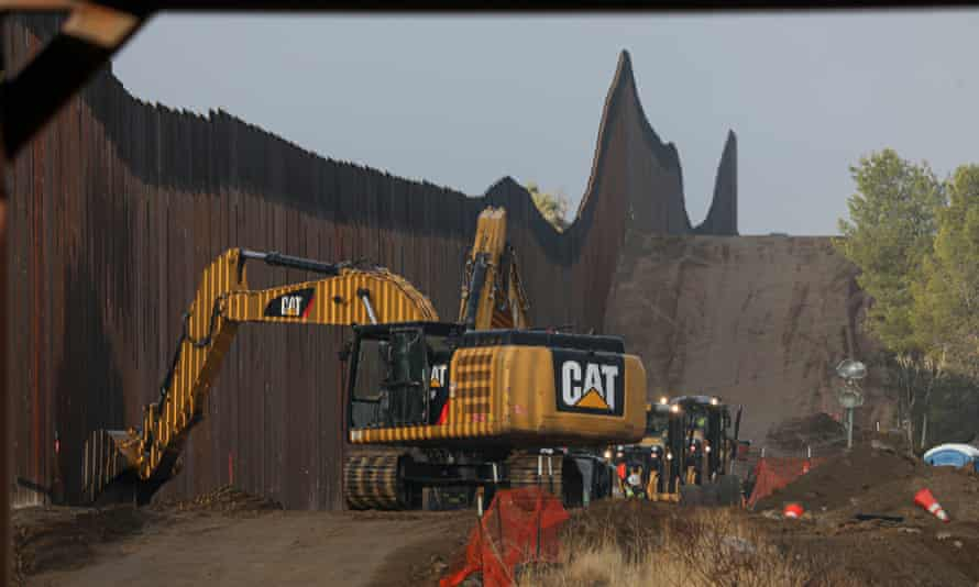Work is done on a new border wall being constructed on 22 January in Jacumba, California.