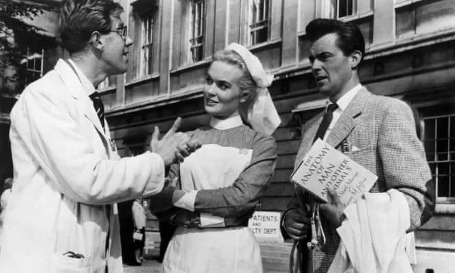 Michael Medwin, left, with Shirley Eaton and Dirk Bogarde in Doctor at Large, 1957.