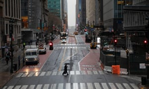 A commuter crosses 42nd Street in front of Grand Central Terminal during morning rush hour, Monday in New York.