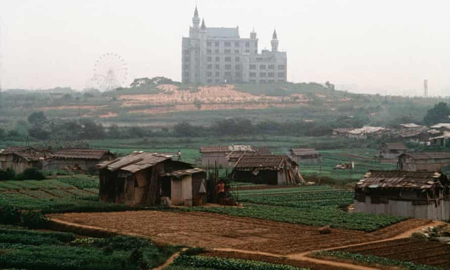 A Disney-like theme park emerges from the green fields surrounding Shenzhen in 1992.