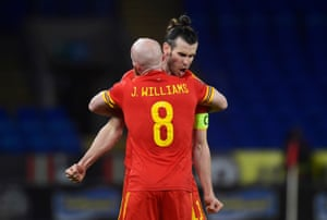 Wales' Gareth Bale and Jonny Williams celebrate after the final whistle.