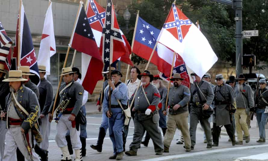 Sons of Confederate Veterans members and others march through downtown Shreveport, Louisiana, on 3 June 2011.