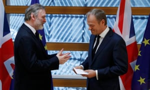 Britain's permanent representative to the European Union, Tim Barrow, hand delivers Theresa May's Brexit letter to EU council president, Donald Tusk