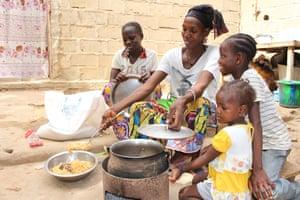 Fatoumata Traoré and her family eat spaghetti in Mali