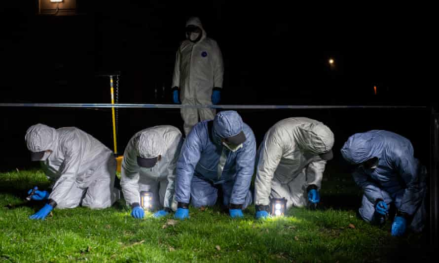 Police officers conduct a fingertip search of Poynders Road, London, where Sarah Everard was last seen.